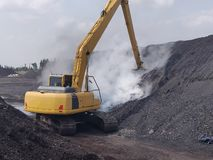 The excavator extinguish fires from coal spontaneous combustion.  royalty free stock image