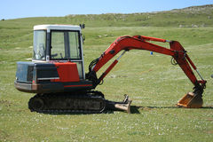 Excavator in field Stock Photo