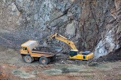Excavator filling the truck Stock Image