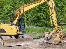 Excavator in the forest preparing construction of  the hiking tr Stock Image