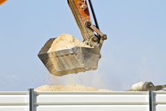 Excavator full of sand Royalty Free Stock Images