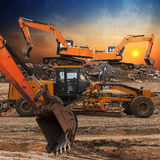 Excavator and grader Royalty Free Stock Images