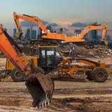Excavator and grader Stock Image
