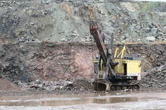 Excavator in a granite quarry Royalty Free Stock Photos