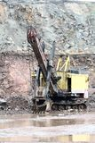 Excavator in a granite quarry Royalty Free Stock Image