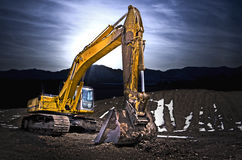 Excavator in gravel mountain Royalty Free Stock Images