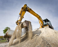 Excavator on the gravel pile Royalty Free Stock Photos