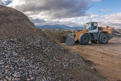 Excavator in a gravel production quarry stock image