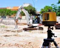 Excavator with hammer demolishes e laser Stock Image