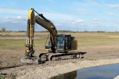 Excavator at Havel river. renaturing of the river in germany royalty free stock images