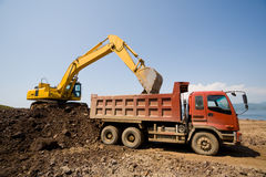 Excavator and heavy dump truck Stock Photography