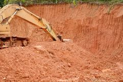 Excavator. Heavy equipment excavator dredge hill being Stock Images