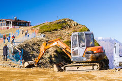 Excavator Hitachi in mountains, Krasnaya Polyana, Sochi Royalty Free Stock Image