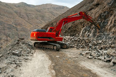 Excavator with hydraulic hammer Royalty Free Stock Photos