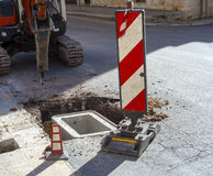 Excavator with hydraulic hammer Stock Photos