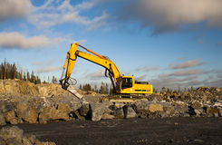 Excavator with Hydraulic Hammer Working in Gravel Pit Stock Photography