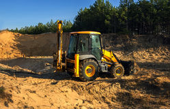 Excavator illegally produces sand, destroying the forest landsca Stock Photo