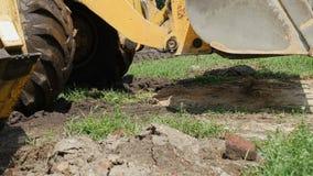 Excavator sets the bucket. Excavator installs the bucket machinery stock video footage