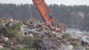 Excavator at landfill at winter, Russia. Excavator at landfill at winter stock video footage