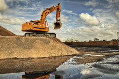 Excavator in a limestone. Quarry - Piles of limestone rocks - Brazil - HDR Stock Photos
