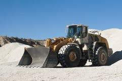 Excavator in a limestone quarry Stock Photos