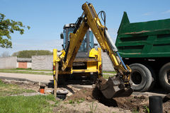 Excavator loaded dumper truck Royalty Free Stock Photography