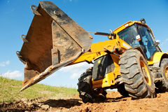 Excavator Loader with backhoe works Stock Photo