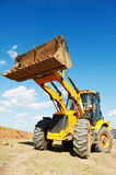 Excavator Loader with backhoe works Royalty Free Stock Photo