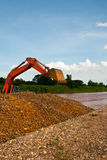 Excavator loader bucket. In river royalty free stock photo