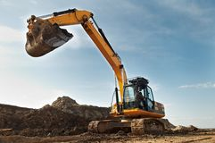 Excavator loader in construction stock image