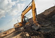 Excavator loader in construction royalty free stock photo