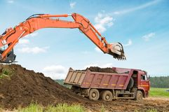 Excavator loader and dumper truck Royalty Free Stock Images