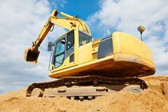 Excavator loader at earthmoving works Royalty Free Stock Photos