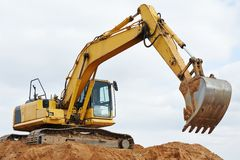 Excavator loader at earthmoving works Royalty Free Stock Images