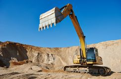 Excavator loader at earthmoving works Royalty Free Stock Photo