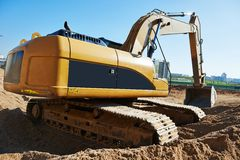 Excavator loader at earthmoving works Stock Photos