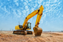 Excavator loader machine during earthmoving Stock Images