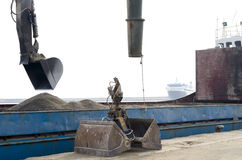 Excavator loader machine at shipyard. Under sunlight Royalty Free Stock Image