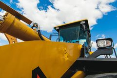 Excavator Loader Machine. Side View of Front Hoe Loader. Industrial Vehicle. Heavy Equipment Machine. Pneumatic Truck. Constructio. N Equipment on a background stock photos