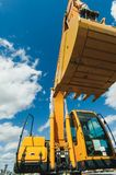 Road-building machinery, tractors yellow excavators in open air in working position. Excavator Loader Machine. Side View of Front Hoe Loader. Industrial Vehicle Royalty Free Stock Images