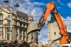 Excavator loader machine works at center city of Lviv Royalty Free Stock Photos
