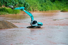 Excavator loader at river Stock Photography