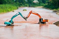 Excavator loader at river Royalty Free Stock Image