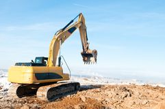 Excavator loader at winter works Royalty Free Stock Images