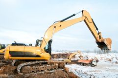 Excavator loader at winter works Royalty Free Stock Photography