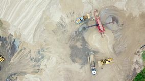 Excavator loader working at sand mine. Mining conveyor at industrial park. Mining machinery at sand quarry. Aerial view of mining. Equipment at sand quarry stock video footage