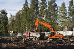 Excavator loading the dump truck Royalty Free Stock Photos