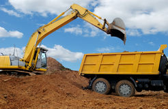 Excavator loading dumper truck Royalty Free Stock Photos