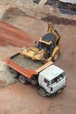 Excavator loading dumper truck Royalty Free Stock Images