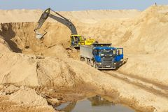 Excavator Loading Dumper Truck Royalty Free Stock Photo